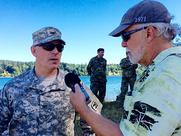 Jeff Hoyt interviews Colonel Brian Grunon of the WA National Guard as his troops land at Jensen Point Monday